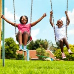 wpid-bigstock-African-Kids-Playing-On-Swing-82278503.jpg